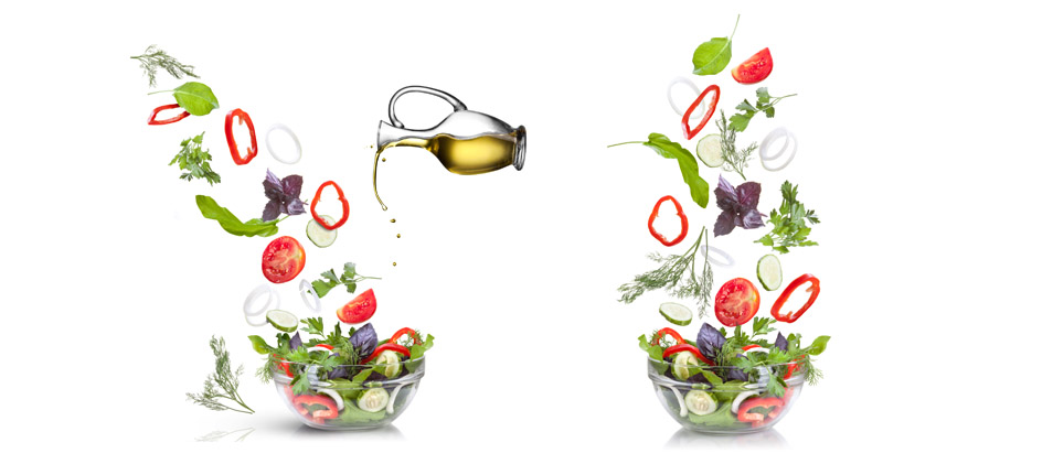 Falling vegetables for salad and oil isolated on white